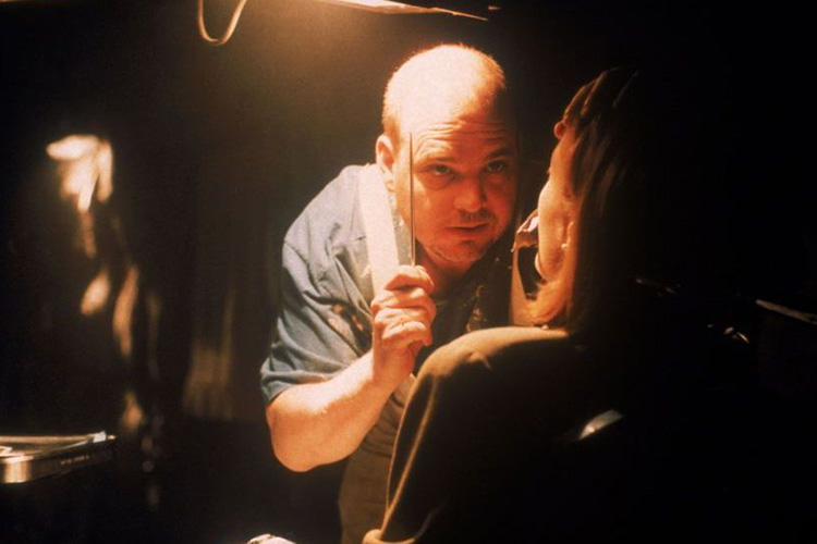 "Pruitt Taylor Vince as Gerry Schnauz faces off with Gillian Anderson's Dana Scully in the creepy ""Unruhe"" Season 4 episode of THE X-FILES."