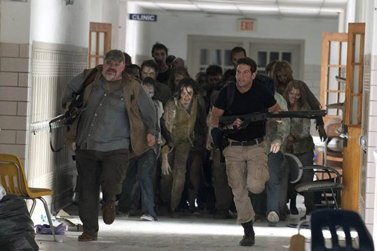 Otis (Pruitt Taylor Vince) and Shane (Jon Bernthal) run for their lives from a horde of walkers in the early episodes of THE WALKING DEAD Season 2.