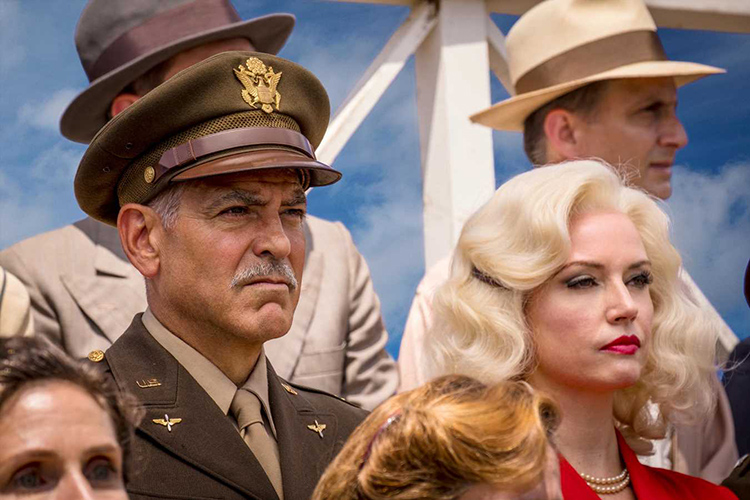 George Clooney as Scheisskopf and Julie Ann Emery as Marion in Hulu drama series CATCH-22 (2019).